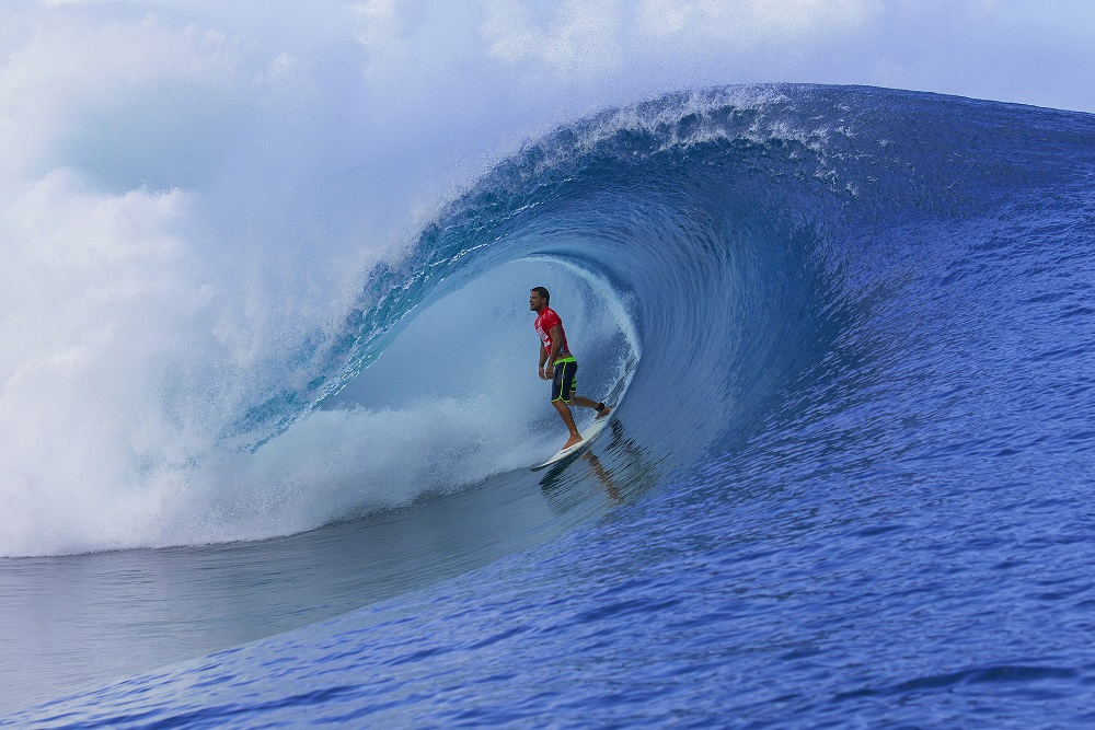 Michel Bourez of Tahiti, French Polynesia (pictured) exits a barrel during Round 1 of the Billabong Pro Tahiti on Monday August 18, 2014. Bourez won his heat deafeating Matt Wilkinson (AUS) and Raoni Monteiro (BRA) advacing directly into Round 3.